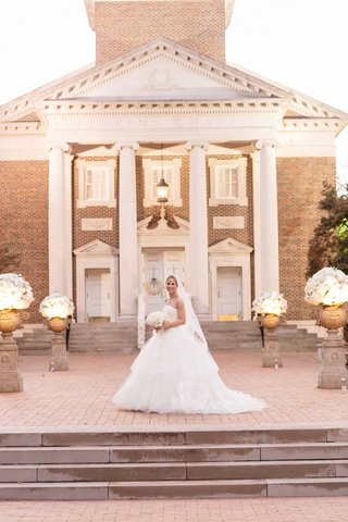 bride-in-vera-wang-wedding-dress-in-front-of-perkins-chapel-at-southern-methodist-university