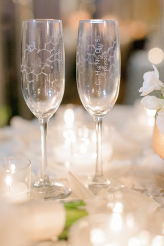 bride-and-grooms-champagne-flutes-with-oxytocin-formula-diagram