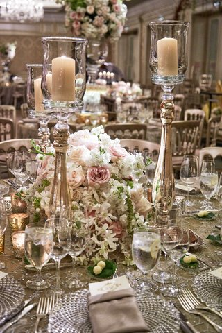 white-pink-rose-wedding-centerpiece-with-tall-candleholder-cut-crystal-charger-plates