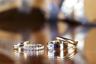 brides-polished-gold-wedding-ring-and-diamond-eternity-band-grooms-yellow-gold-wedding-rings