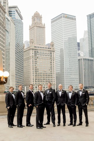 groom-in-hugo-boss-with-groomsmen-in-black-tuxedos-hands-in-pocket-downtown-chicago