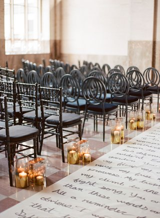 wedding-ceremony-handwritten-poems-and-love-letters-on-aisle-runner-canvas-black-chairs-round