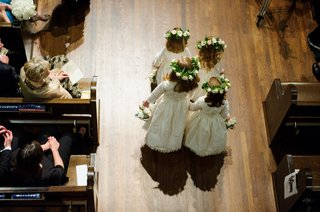 aerial-birds-eye-view-of-flower-girls-four-walking-down-wood-floor-aisle-church-wedding-ceremony