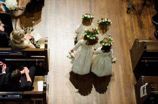 aerial-birds-eye-view-of-flower-girls-four-walking-down-wood-floor-aisle-church-wedding-ceremony