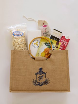 burlap-welcome-bag-filled-with-popcorn-with-stamp-of-monogram-hangover-kit-electrolyte-drink