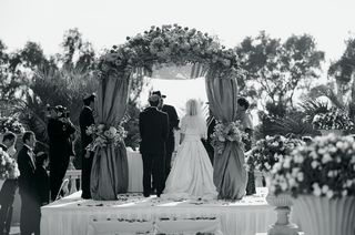 black-and-white-photo-of-couple-at-ceremony-altar