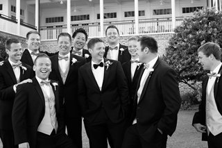 black-and-white-photo-of-groom-and-groomsmen-in-tuxedos-and-bow-ties