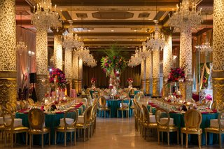 opulent-and-vast-gold-turquoise-color-palette-with-differing-sizes-of-floral-arrangements