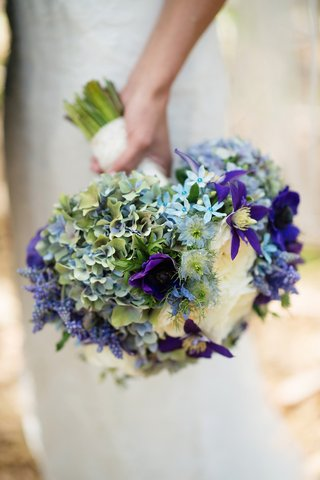 melissa-claire-egan-wedding-bouquet-with-blue-and-purple-flowers
