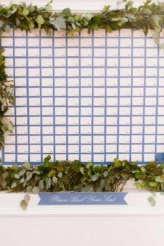 wedding-reception-wall-display-of-escort-cards-on-blue-background-taxi-car-service-theme-please-hail
