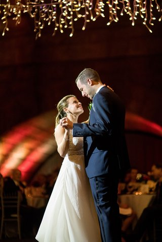 wedding-reception-in-new-york-city-archway-icicle-lights-twinkle-lights-romantic-first-dance