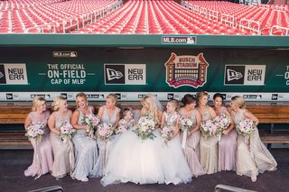 bridesmaids-in-sparkly-long-dresses-mismatched-styles-and-colors-at-busch-stadium-in-st-louis
