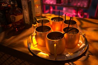 moscow-mules-in-copper-cups-on-silver-tray-at-moroccan-style-engagement-party