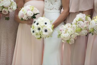 bridal-bouquet-with-anemone-blossoms-bridesmaid-bouquets-with-peonies
