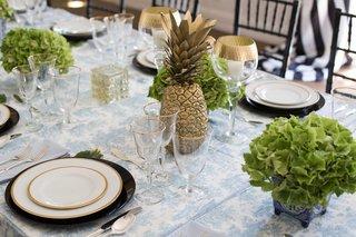 southern-inspired-wedding-summer-reception-decor-pineapple-gold-centerpiece-green-hydrangea