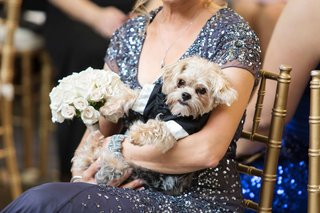 brides-mom-holding-puppy-in-tux-and-white-pink-bouquet-ceremony