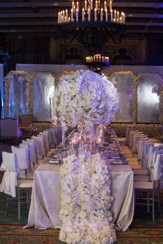 wedding-reception-white-chair-cover-linen-with-thick-flower-runner-that-matches-centerpieces