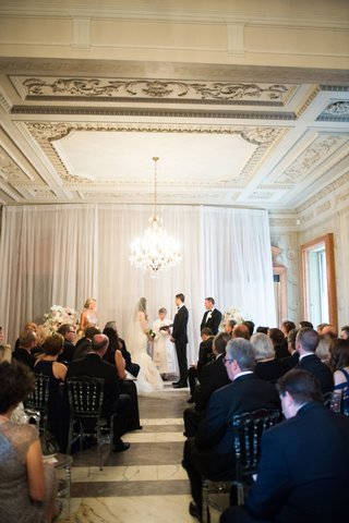 ceremony-in-washington-dc-at-anderson-house-simple-decor-chandelier
