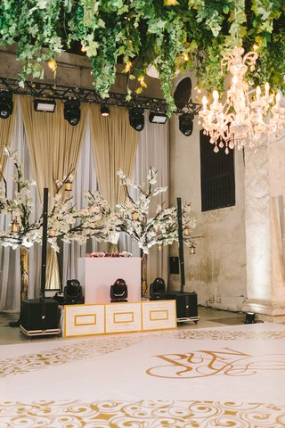colombia-wedding-reception-greenery-chandelier-ceiling-installation-white-gold-dj-booth-dance-floor