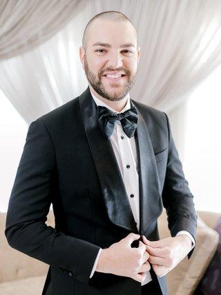 groom-in-malcolm-alexander-tuxedo-groom-in-black-tuxedo-with-large-bow-tie