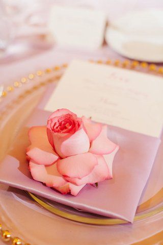 place-setting-with-lavender-napkin-pink-rose-and-charger-with-gold-rim