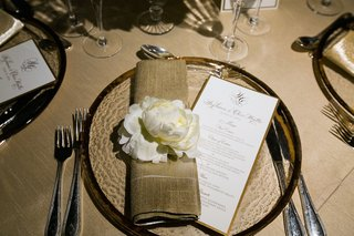 gold-rim-charger-with-white-peony-at-wedding-reception