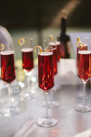 signature-cocktails-in-champagne-flutes-with-rind