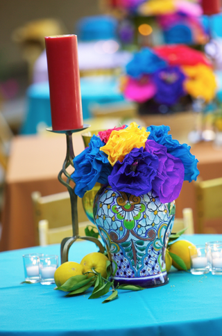 brightly-colored-flower-arrangement-with-lemons