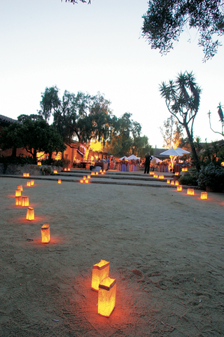 path-of-paper-bag-lanterns-in-sand