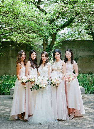 bride-with-bridesmaids-in-light-pink-high-low-dresses-strapless-pregnant-bridesmaid-different-gown