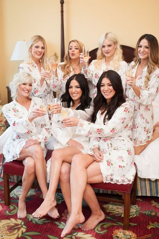 bride-and-bridesmaids-in-floral-robes-with-champagne