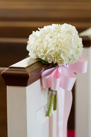 white-hydrangeas-tied-to-church-pew-with-pink-ribbon