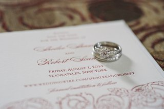 engagement-ring-and-wedding-bands-on-invitation