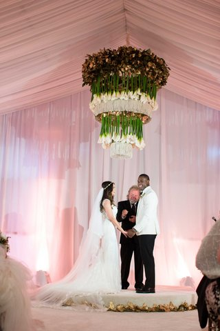 demarco-murray-and-heidi-mueller-wedding-ceremony-upside-down-calla-lily-chandelier-gold-leaves