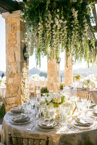 malibu-rocky-oaks-wedding-chandeliers-dripping-with-white-flowers-and-greenery
