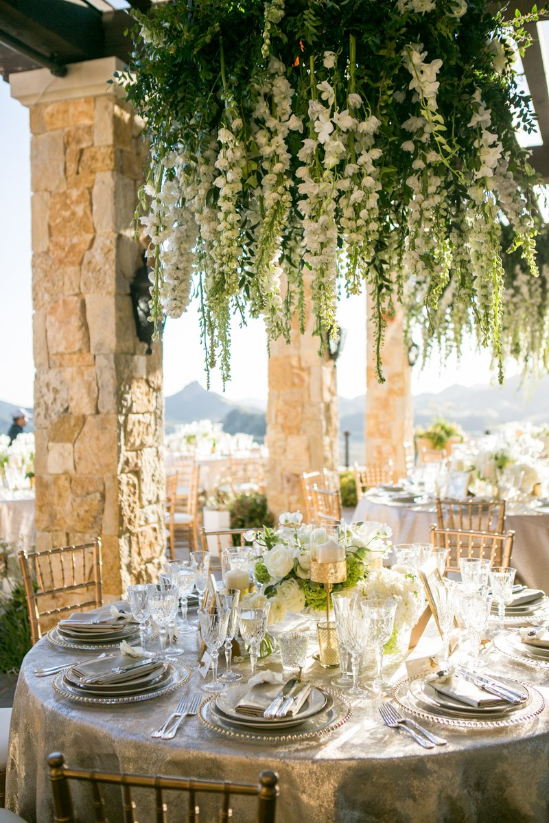 wedding reception low centerpiece with flower chandelier over table