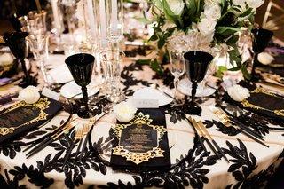 wedding-reception-black-white-sequins-black-gold-silverware-flatware-black-goblet-wine-glass-luxe