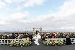 wedding-ceremony-overlooking-los-angeles-california-rustic-wedding-ceremony-greenery-pink-flowers