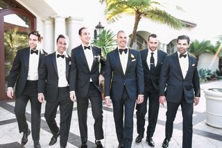 groom-in-tom-ford-suit-tuxedo-bow-tie-with-friends-since-no-groomsmen-just-best-man