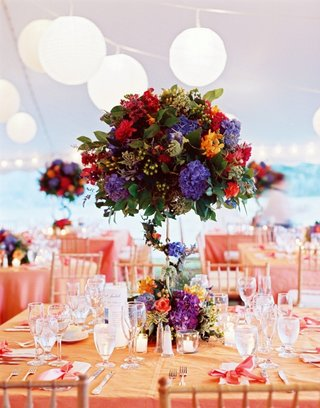 colorful-tent-wedding-flower-centerpiece-at-reception