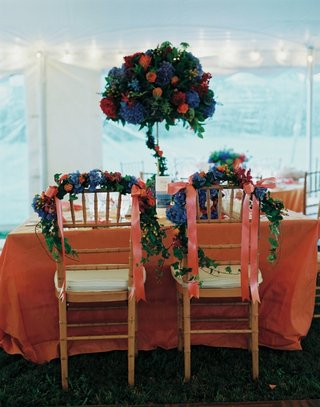 couples-table-with-orange-linen-and-blue-flower-centerpiece