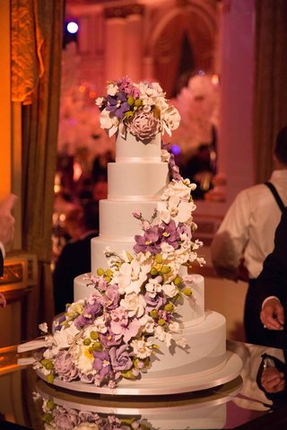 six-layer-wedding-cake-with-purple-white-orchid-peony-rose-sugar-flowers-cascading-down-side