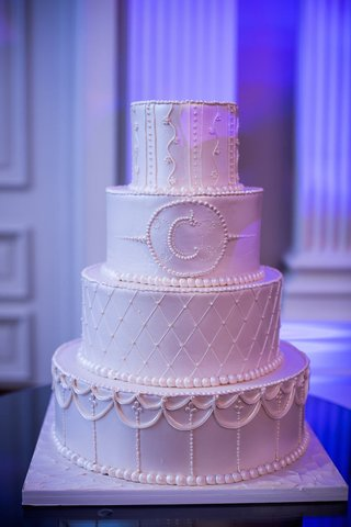 white-wedding-cake-with-a-different-piped-pattern-on-each-layer-initial-of-couples-surname