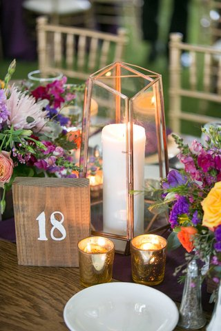colorful-berry-tone-floral-centerpieces-rustic-wooden-table-number-votives-candles-china