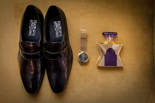 salavatore-ferragamo-mens-black-dress-shoes-with-gold-watch-and-cologne-bottle