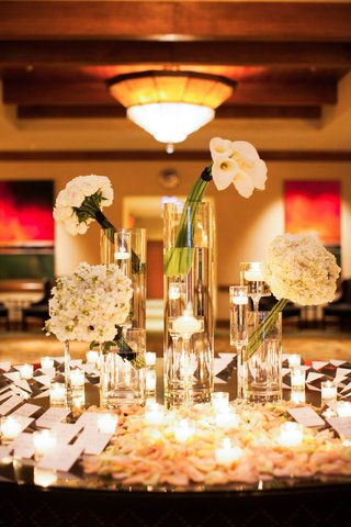 escort-card-table-with-rose-petals-candlelight-and-bouquets
