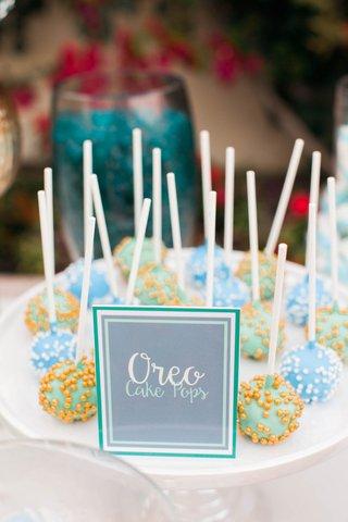 gourmet-oreo-cake-pops-in-blue-green-with-sprinkles-for-dessert-bar