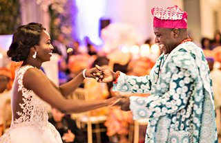 bride-in-illusion-back-wedding-dress-dances-with-father-of-bride-in-traditional-nigerian-attire