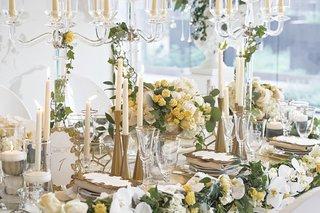 gold-hourglass-shaped-candlesticks-at-wedding-reception-modern-gold-candlesticks