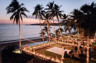 destination-wedding-reception-overlooking-beach-ocean-palm-trees-dance-floor-u-shaped-table-long